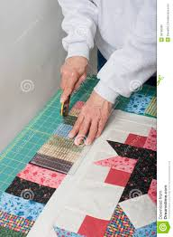 Quilter Trimming Piano Keys Of Quilt Top Fabric. Stock Photo ... & Royalty-Free Stock Photo. Download Quilter Trimming Piano Keys Of Quilt ... Adamdwight.com