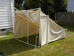 exterior awesome home made tent made of creamy cover and white metal pole that applied