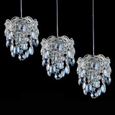 beautiful blue crystal beads and chrome finish detailing add mystery to graceful multi light pendant