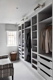 Huge Closets love the use of distinctive wallpaper and lighting in this custom 7193 by xevi.us