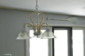 rope wrapped chandelier updating a boring light fixture rope wrapped chandelier refresh rope wrapped chandelier diy