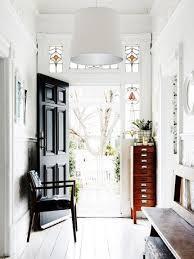 A white paneled entry way frames a gorgeous hallway boasti