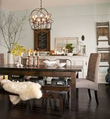 rustic wooden floors punctuate the kitchen creating an eye catching contrast against the farmhouse style white cabinets and brick inspired back splash