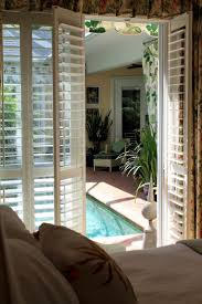 rolling shutters for sliding glass doors track plantation shutter door outside ideas security perth dry hardware
