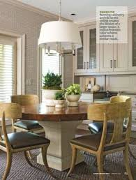 love the table subway tile wallpaper rustic dining table with white pedestal base modern pendant light or chandelier eat in kitchen room