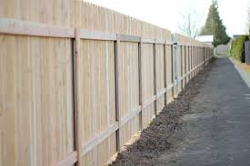 Metal fence post Angled Steel Posts Support Cedar Fence Xcel Why Choose Metal Posts For Wood Fences Cascade Fence Deck
