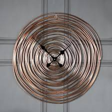 large vintage copper swirl wall clock
