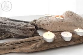 DIY Driftwood Votive Candle Holders, via www.thegoldjellybean.com
