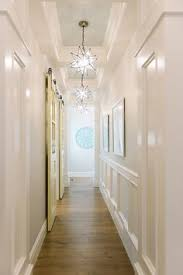 lighting a hallway. hallway ideas with paneled walls tray ceiling planks painted in blue lighting a
