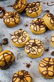 First, make the base frosting, which is the espresso frosting, basically a cream cheese frosting with espresso powder and kahlua. Coffee Macarons Detailed Recipe And Step By Step Video Tutorial