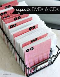 reduce storage space by using the cd and dvd sleeves make alphabet dividers out of