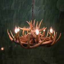 unique wagon wheel chandelier with chains and small lamps plus wallpaper also wooden flooring for interior amazing wooden chandelier