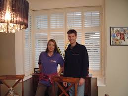 sam and julia with the bay window shutters fitted on diy sos