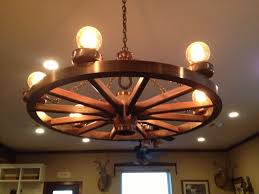 wagon wheel lighting. wagon wheel chandelier with antique light bulbs lighting
