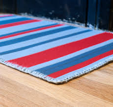 image of red and blue kitchen rugs