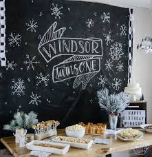 using a dropcloth to create a diy giant chalkboard backdrop for
