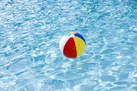 Fine Pool Water With Beach Ball Floating On Surface Of Swimming Intended Design Ideas