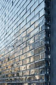 facade detail of Cool and Peaceful House with Optical Glass Facade