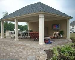cabana with outdoor kitchen fireplace