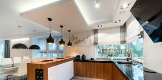 modern kitchen interior design in black and white style showign pundants ambient lights ambient kitchen lighting