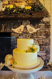 Rustic Yellow Fondant Wedding Cake With Bird Toppers