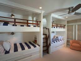 These four bunk beds actually sleep six thanks to two trundle beds that  pull out from