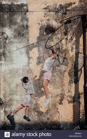 famous creative penang street art on the wall of unesco heritage buffer zone george town on famous wall art in penang with penang street art stock photos penang street art stock images alamy
