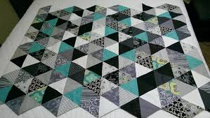 Large 60 Degree Triangle Ruler (3''-9'' Finished Side) | JOANN & Triangle baby quilt made with this ruler. Adamdwight.com