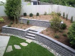 building a cinder block retaining wall block retaining wall with green grass cinder block retaining wall
