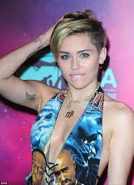 Miley Cyrus Album Charts Miley Cyrus Ariana Grande And Katy Perry Go Head To Head