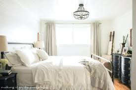 hanging a chandelier in a bedroom chandeliers hanging chandelier wall bedroom chandeliers modern dining room hanging a chandelier in a bedroom