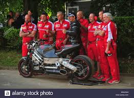 ferrari 2015 bike. 26th june 2015 ferrari mechanics pose with the mad max bike at goodwood festival of speed major automotive event attracts thousands people to t