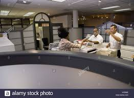 office cubical. View Of Office Worker At Copy Machine Over Cubicle Wall - Stock Image Cubical