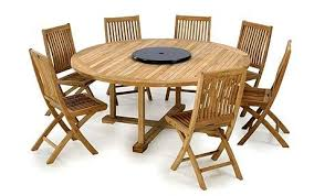 kingshall is offering 50 per cent off this 6ft round solid teak table with eight chairs