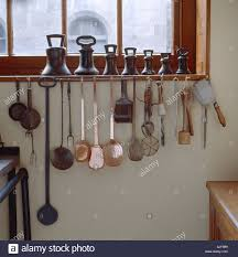 Kitchen Window Shelf Row Of Hooks Under The Kitchen Window With Utensils At Penrhyn