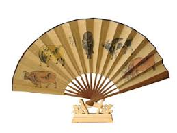 fan on stand. folding fan originated from japan.in northern song dynasty, the as a tribute were introduced into china, but not yet widely used, on stand