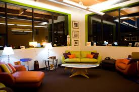 beautiful bright office. beautiful office space bright colored sofas white painted lower walls glass upper dark flooring