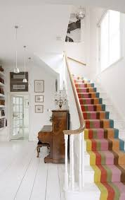 carpet ideas for stairs and landing. beautiful colourful striped stair carpet against the white. high street home blog: feature staircases ideas for stairs and landing