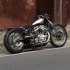 gone is the sporty s stock suspension replaced by a pair of rigid struts in the rear and clic harley springer forks up