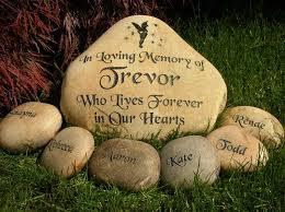 large engraved river rock memorial