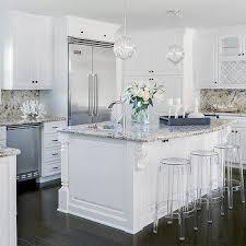 white kitchen cabinets with tan granite countertops