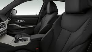 side close up of the front seats of the bmw 3 series sedan with model