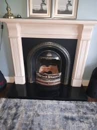 modern fireplace surround insert and fittings for