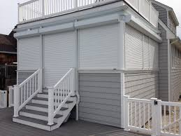 exterior wood storm shutters. wonderful traditional exterior design using hurricane shutters decoration with white railing and wooden siding wood storm