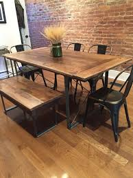 reclaimed wood dining room table. reclaimed wood table from floor boards. love the texture between and metal chairs. | home pinterest table, metals woods dining room