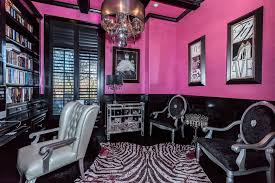 eclectic home office. Eclectic Home Office With Beam Ceiling, Chandelier, Pink Walls, Black Wainscoting And Built-in Shelving.Source: Zillow Digs