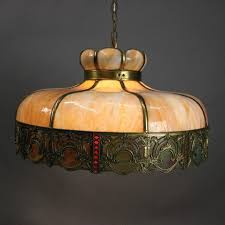 antique arts and crafts chandelier features filigree bronze shade with two tone beige amp