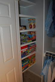 this picture shows the finished left side of the closet with toys already loading the shelves