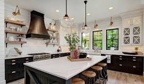 use open shelving to display your dishware and to bring a casual feel to the room image caesarstone collect this idea