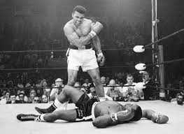 Image result for boxer Cassius Clay, defeats highly favored heavyweight champion Sonny Liston and claims his first title.